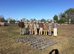 ARG-290-hunters-with-big-bag-of-pigeons-laid-out